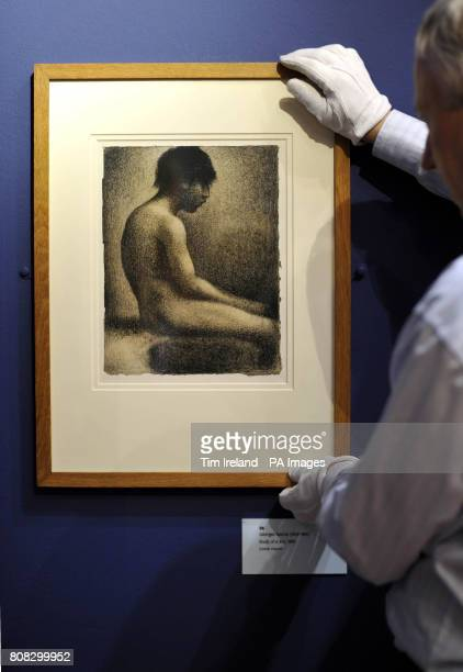 A drawing by Georges Seurat titled Study of a Boy dated 1883 is viewed at The Wallace Collection in London as part of their exhibition Poussin to...