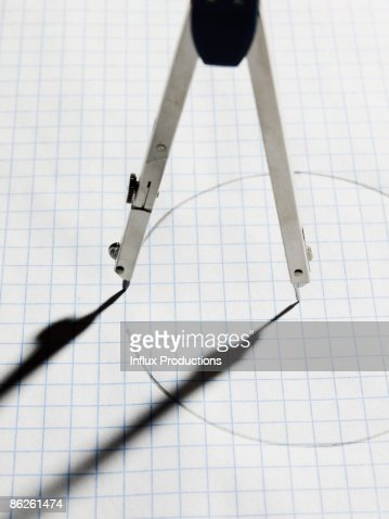 Drawing compass completing circle : Stock Photo