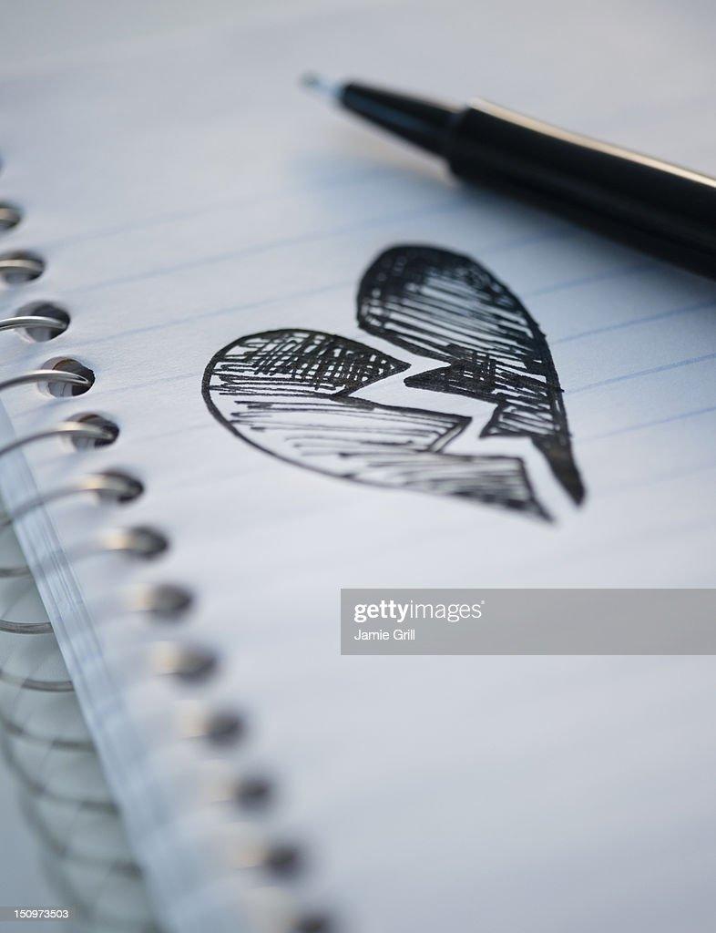 Drawing depicting broken heart : Stock Photo