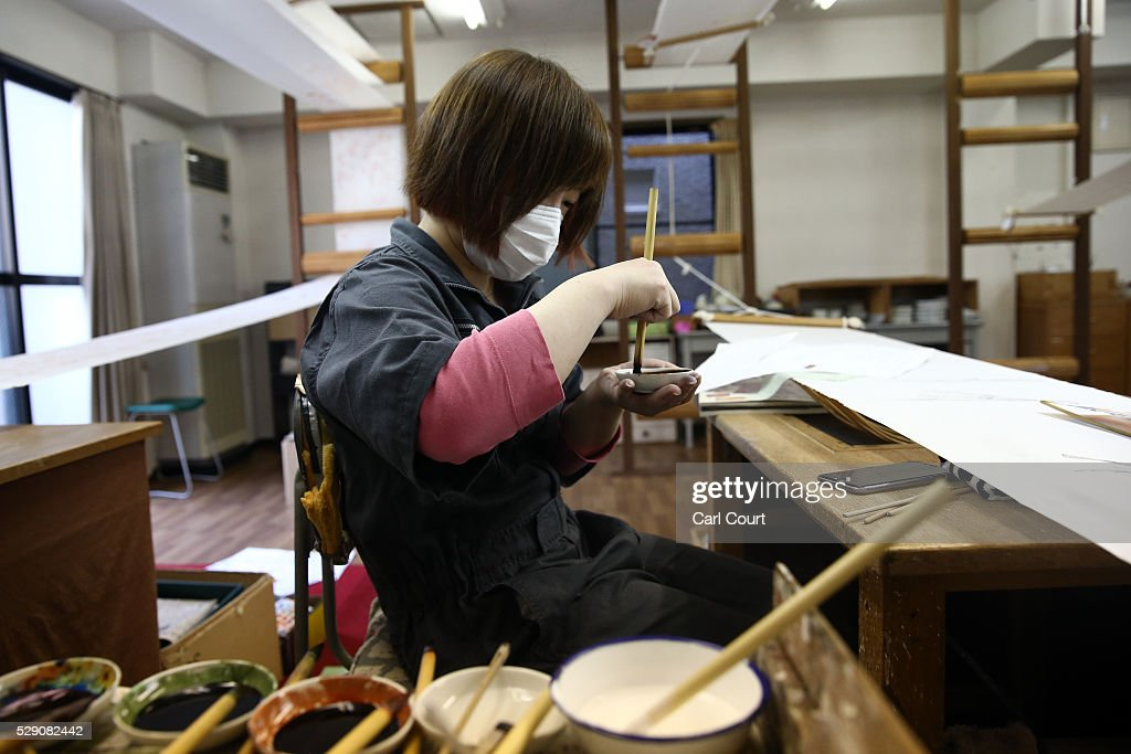 Drawing master Junko Seki paints a design on kimono fabric during a stage of its production process at the Sensyo Ichikawa kimono workshop on April...