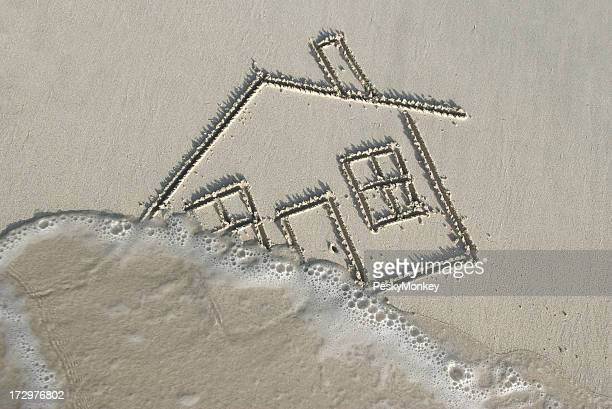 Drawing of a Home in Sand Swept Away by Wave