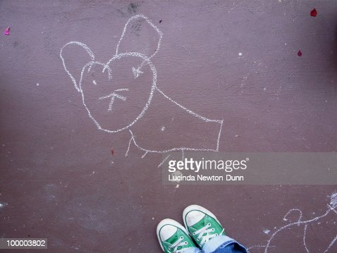 Drawing of a mouse in chalk on the ground. : Stock Photo