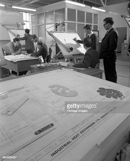 Drawing office scene Edgar Allen's steel foundry Sheffield South Yorkshire 1964 Technicians discussing the drawings The foreground shows the...