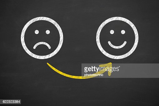 Drawing Unhappy and Happy Smileys on Chalkboard : Foto de stock