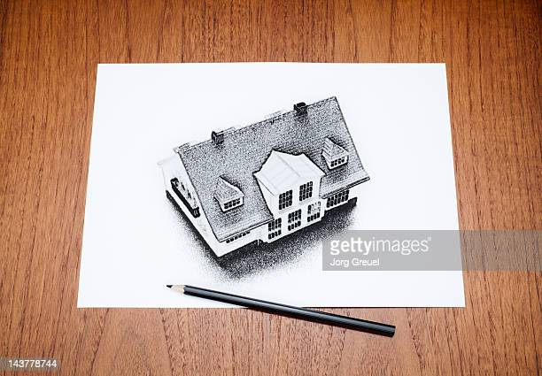 A drawn house on a paper sheet