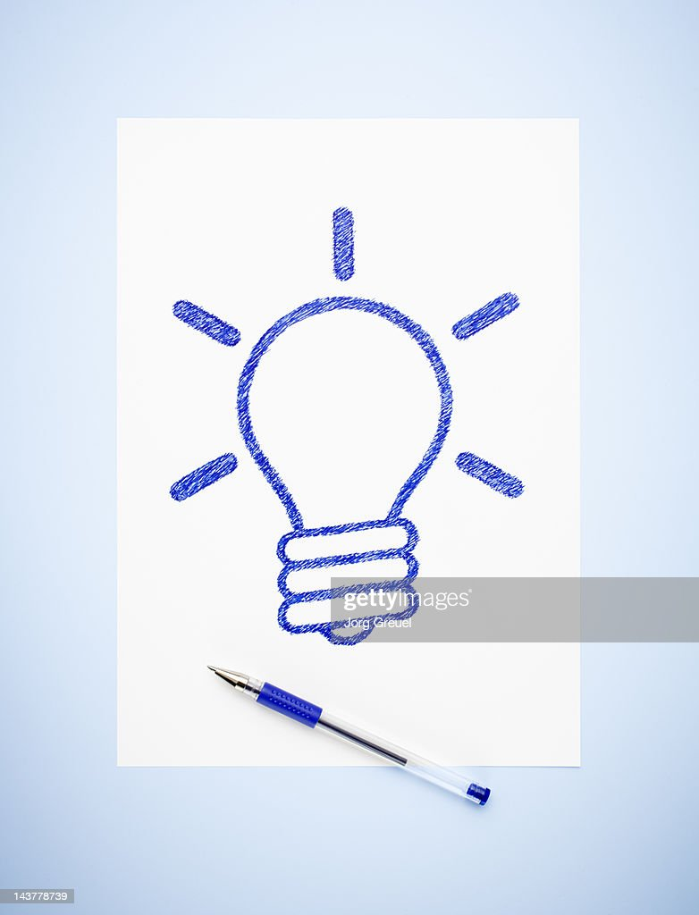A drawn light bulb on a paper sheet : Stock Photo