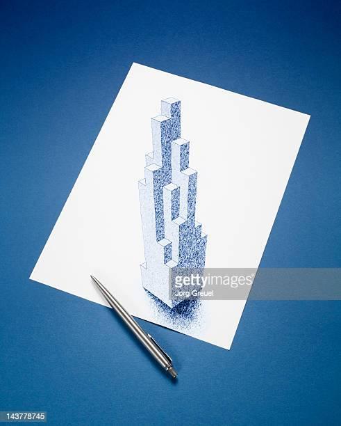 A drawn skyscraper on a paper sheet