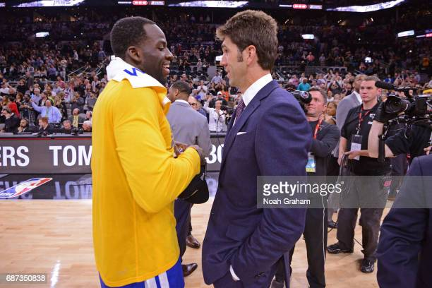 Draymond Green and Bob Meyers of the Golden State Warriors talk on the court after winning Game Four of the Western Conference Finals against the San...