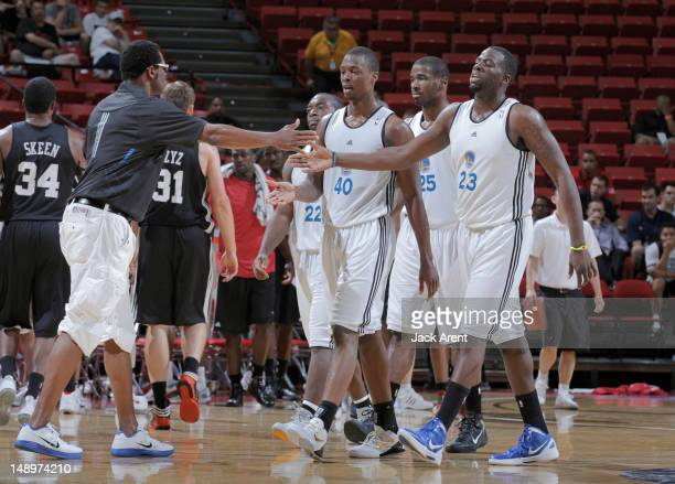 Draymond Green and Harrison Barnes greets Assistant Coach Pete Myers of the Golden State Warriors against the Chicago Bulls during NBA Summer League...
