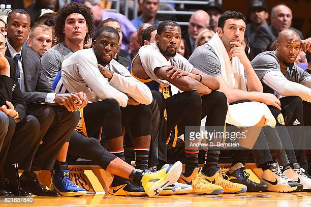 Draymond Green and Kevin Durant of the Golden State Warriors sit on the bench during the game against the Los Angeles Lakers on November 4 2016 at...