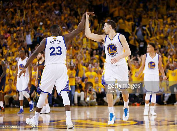Draymond Green and Klay Thompson of the Golden State Warriors celebrate in the fourth quarter against the Cleveland Cavaliers during Game Five of the...
