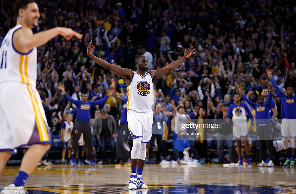 <a gi-track='captionPersonalityLinkClicked' href=/galleries/search?phrase=Draymond+Green&family=editorial&specificpeople=5628054 ng-click='$event.stopPropagation()'>Draymond Green</a> #23 and <a gi-track='captionPersonalityLinkClicked' href=/galleries/search?phrase=Klay+Thompson&family=editorial&specificpeople=5132325 ng-click='$event.stopPropagation()'>Klay Thompson</a> #11 of the Golden State Warriors react after Andre Iguodala #9 made a three-point basket against the Milwaukee Bucks at ORACLE Arena on December 18, 2015 in Oakland, California.