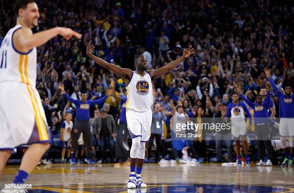 Draymond Green and Klay Thompson of the Golden State Warriors react after Andre Iguodala made a threepoint basket against the Milwaukee Bucks at...