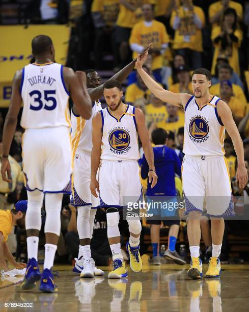 Draymond Green and Klay Thompson of the Golden State Warriors react with Stephen Curry against the Utah Jazz during Game Two of the NBA Western...