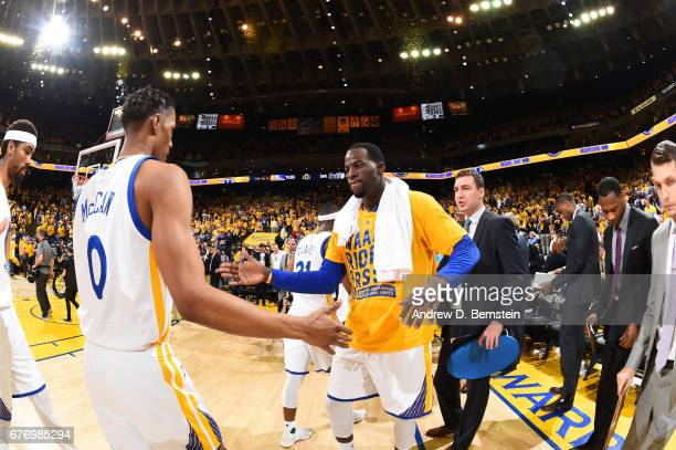 Draymond Green and Patrick McCaw of the Golden State Warriors celebrate after Game One of the Western Conference Semifinals of the 2017 NBA Playoffs...
