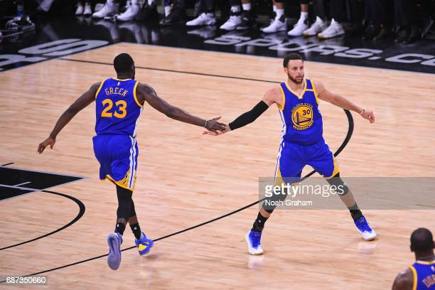 Draymond Green and Stephen Curry of the Golden State Warriors high five in Game Four of the Western Conference Finals against the San Antonio Spurs...