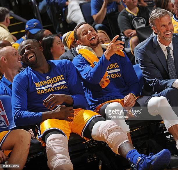 Draymond Green and Stephen Curry of the Golden State Warriors smile and laugh on the bench during the game against the Los Angeles Lakers on November...