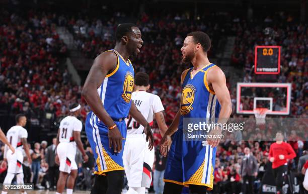 Draymond Green and Stephen Curry of the Golden State Warriors talk against the Portland Trail Blazers in Game Three of the Western Conference...