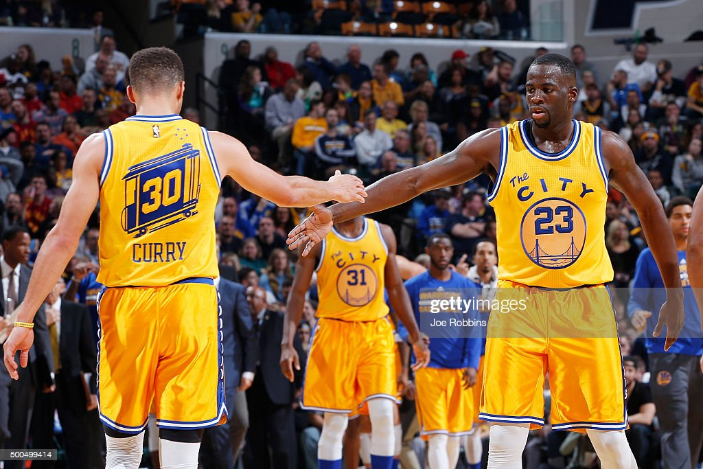 Draymond Green #23 and Stephen Curry #30 of the Golden State Warriors celebrate against the Indiana Pacers in the second half of the game at Bankers Life Fieldhouse on December 8, 2015 in Indianapolis, Indiana. The Warriors defeated the Pacers 131-123 to move to 23-0 on the season.