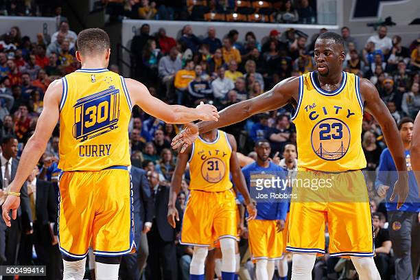 Draymond Green and Stephen Curry of the Golden State Warriors celebrate against the Indiana Pacers in the second half of the game at Bankers Life...