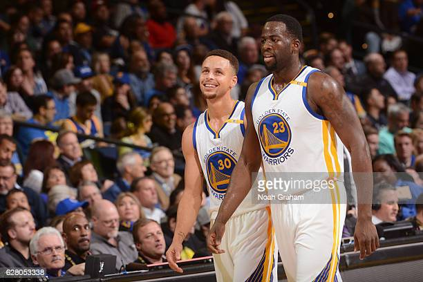 Draymond Green and Stephen Curry of the Golden State Warriors walk off the court after the game against the Indiana Pacerson December 5 2016 at...