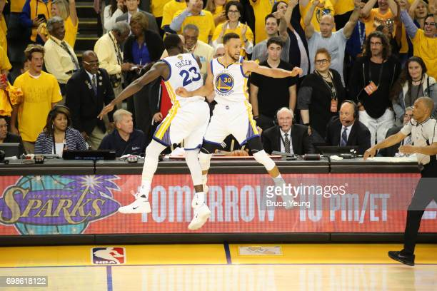 Draymond Green and Stephen Curry of the Golden State Warriors celebrate with a chest bump in Game Five of the 2017 NBA Finals against the Cleveland...