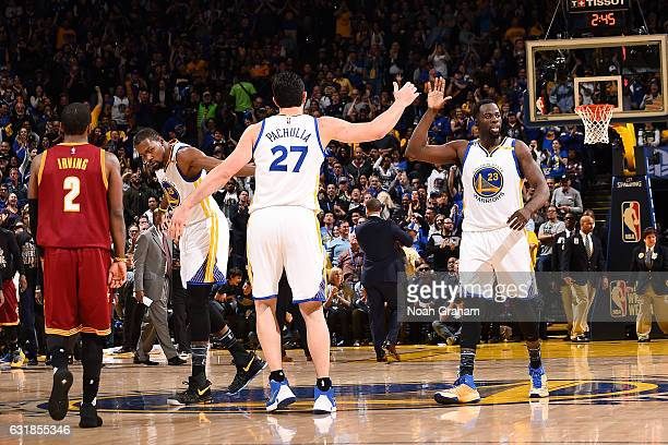 Draymond Green and Zaza Pachulia of the Golden State Warriors high five each other during the game against the Cleveland Cavaliers on January 16 2017...