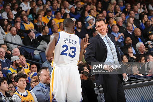 Draymond Green chats with Interim Head coach Luke Walton of the Golden State Warriors while facing the Charlotte Hornets on January 4 2016 at Oracle...