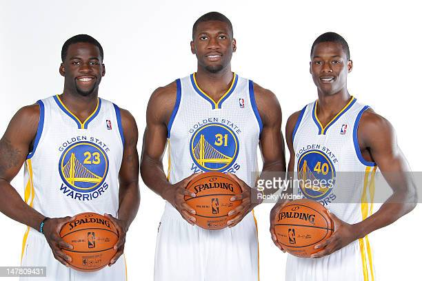 Draymond Green Festus Ezeli and Harrison Barnes of the Golden State Warriors pose for a photo at the Warriors draft pick press conference on July 2...