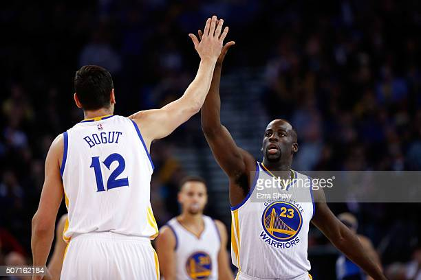 Draymond Green highfives Andrew Bogut of the Golden State Warriors during their game against the Dallas Mavericks at ORACLE Arena on January 27 2016...