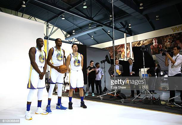 Draymond Green Kevin Durant and Klay Thompson of the Golden State Warriors pose with their Olympic Gold medals for NBA team photographer Noah Graham...