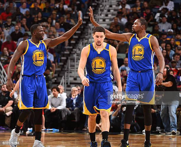 Draymond Green Kevin Durant and Klay Thompson of the Golden State Warriors celebrate during a game against the New Orleans Pelicans at Smoothie King...