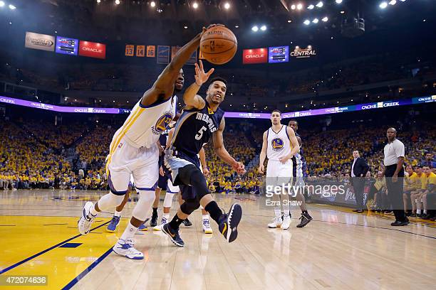 Draymond Green of the Golden State Warriors and Courtney Lee of the Memphis Grizzlies go for a loose ball during Game One of the Western Conference...