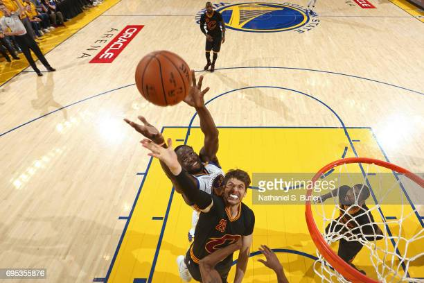 Draymond Green of the Golden State Warriors and Kyle Korver of the Cleveland Cavaliers go up for a rebound in Game Five of the 2017 NBA Finals on...