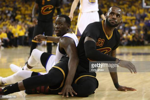 Draymond Green of the Golden State Warriors and LeBron James of the Cleveland Cavaliers fall to the floor during the first half in Game 5 of the 2017...