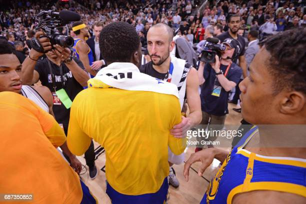 Draymond Green of the Golden State Warriors and Manu Ginobili of the San Antonio Spurs greet each other on the court after Game Four of the Western...