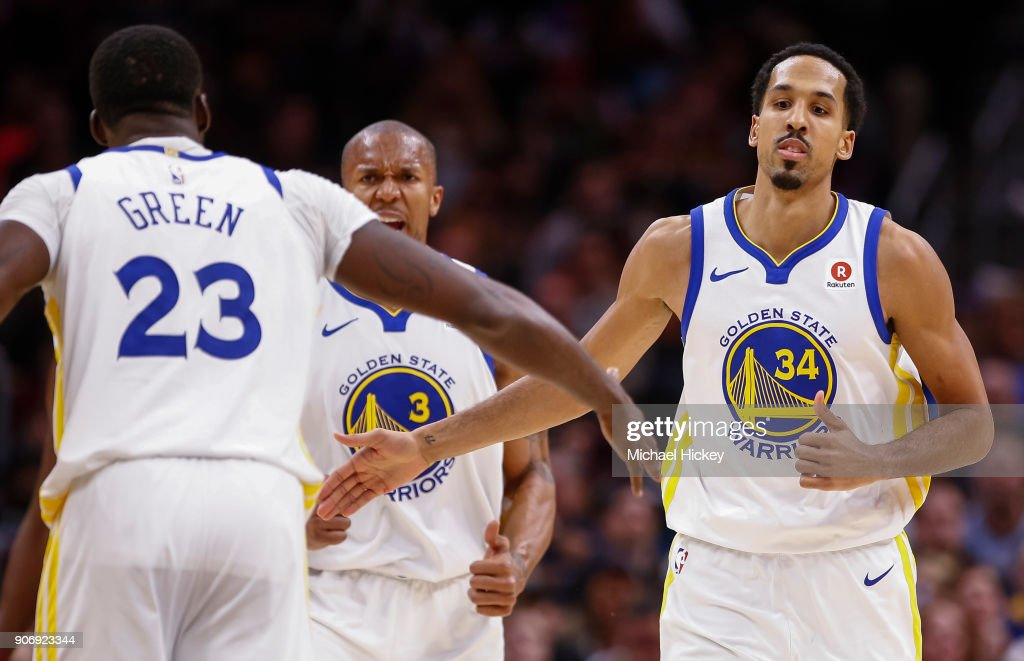 Draymond Green #23 of the Golden State Warriors and Shaun Livingston #34 of the Golden State Warriors celebrate during the game against the Cleveland Cavaliers at Quicken Loans Arena on January 15, 2018 in Cleveland, Ohio.