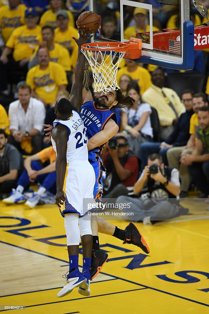Draymond Green #23 of the Golden State Warriors blocks a shot by Steven Adams #12 of the Oklahoma City Thunder during game one of the NBA Western Conference Final at ORACLE Arena on May 16, 2016 in Oakland, California.