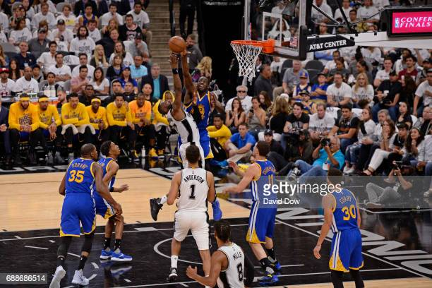 Draymond Green of the Golden State Warriors blocks the shot of Jonathon Simmons of the San Antonio Spurs in Game Four of the Western Conference...