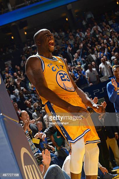 Draymond Green of the Golden State Warriors celebrates a play against the Toronto Raptors on November 17 2015 at Oracle Arena in Oakland California...