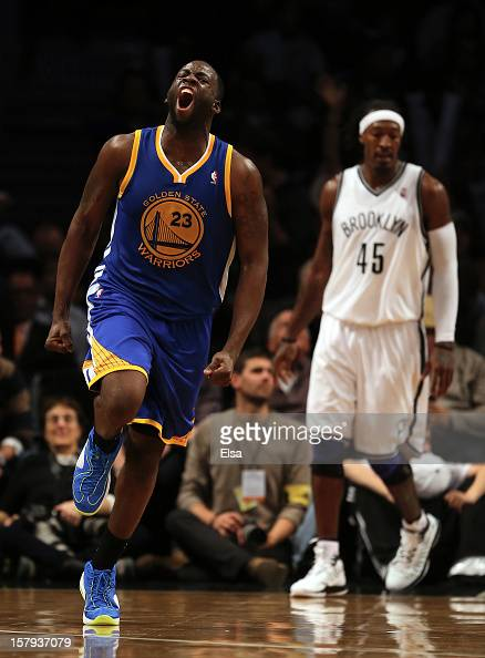 Draymond Green of the Golden State Warriors celebrates in the final minute of the game as Gerald Wallace lof the Brooklyn Nets stands by on December...