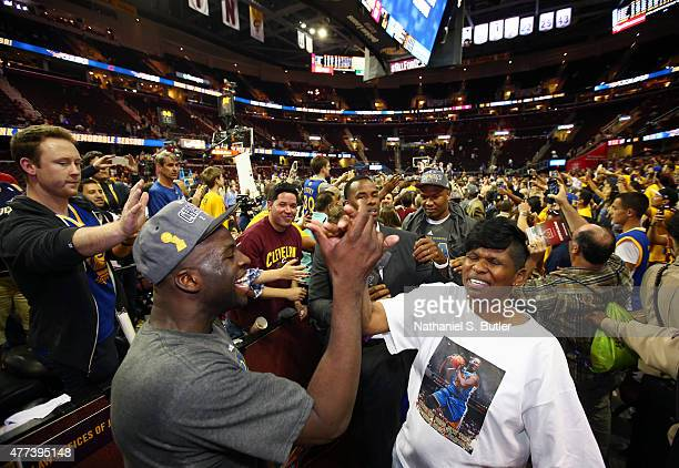 Draymond Green of the Golden State Warriors celebrates with his mother after the Golden State Warriors win Game Six of the 2015 NBA Finals at The...