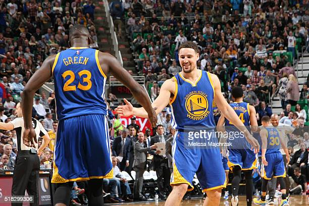 Draymond Green of the Golden State Warriors celebrates with Klay Thompson of the Golden State Warriors during the game against the Utah Jazz on March...