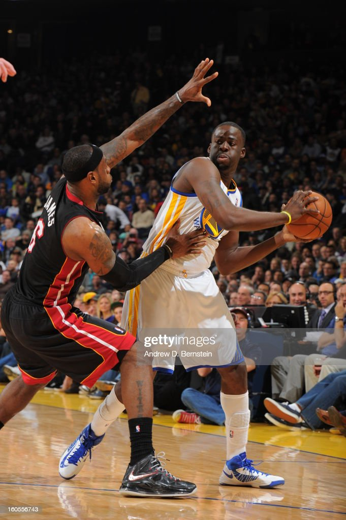 Draymond Green #23 of the Golden State Warriors controls the ball against LeBron James #6 of the Miami Heat on January 16, 2013 at Oracle Arena in Oakland, California.