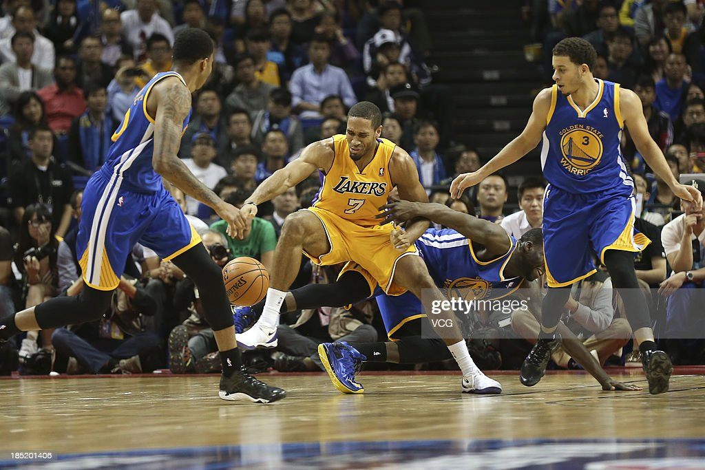<a gi-track='captionPersonalityLinkClicked' href=/galleries/search?phrase=Draymond+Green&family=editorial&specificpeople=5628054 ng-click='$event.stopPropagation()'>Draymond Green</a> #23 of the Golden State Warriors defends against <a gi-track='captionPersonalityLinkClicked' href=/galleries/search?phrase=Xavier+Henry&family=editorial&specificpeople=5792007 ng-click='$event.stopPropagation()'>Xavier Henry</a> #7 of the Los Angeles Lakers during the 2013 Global Games at the Mercedes-Benz Arena on October 18, 2013 in Shanghai, China.