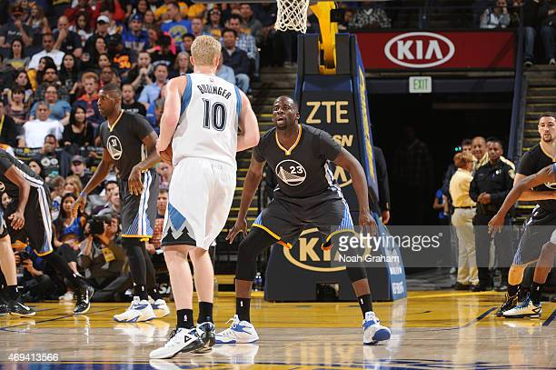 Draymond Green of the Golden State Warriors defends Chase Budinger of the Minnesota Timberwolves on April 11 2015 at Oracle Arena in Oakland...