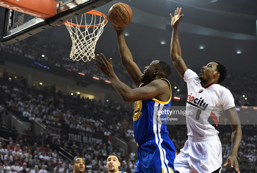 Draymond Green #23 of the Golden State Warriors drive to the basket on Al-Farouq Aminu #8 of the Portland Trail Blazers during the first quarter of Game Four of the Western Conference Semifinals during the 2016 NBA Playoffs at the Moda Center on May 9, 2016 in Portland, Oregon.