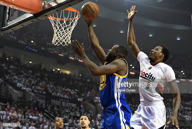Draymond Green of the Golden State Warriors drive to the basket on AlFarouq Aminu of the Portland Trail Blazers during the first quarter of Game Four...