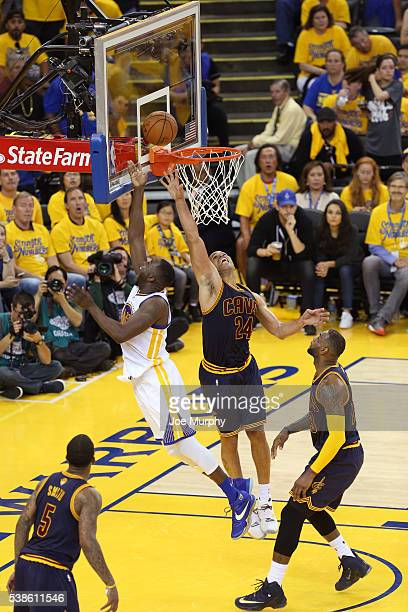 Draymond Green of the Golden State Warriors drives to the basket and shoots the ball while guarded by Richard Jefferson of the Cleveland Cavaliers...