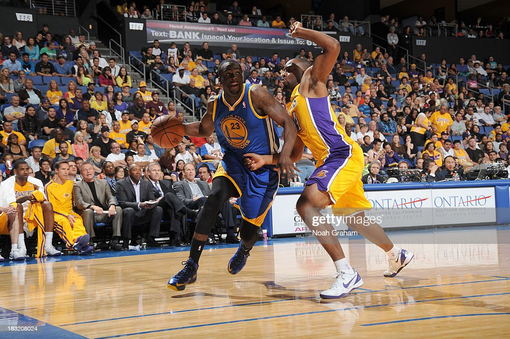 <a gi-track='captionPersonalityLinkClicked' href=/galleries/search?phrase=Draymond+Green&family=editorial&specificpeople=5628054 ng-click='$event.stopPropagation()'>Draymond Green</a> #23 of the Golden State Warriors drives to the basket against <a gi-track='captionPersonalityLinkClicked' href=/galleries/search?phrase=Marcus+Landry&family=editorial&specificpeople=2095929 ng-click='$event.stopPropagation()'>Marcus Landry</a> #14 of the Los Angeles Lakers at Citizens Business Bank Arena on October 5, 2013 in Ontario, California.